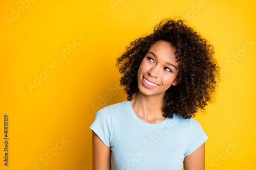 Photo portrait of thoughtful african american girl looking at blank space isolated on vivid yellow colored background - fototapety na wymiar