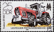 """GERMANY, DDR - CIRCA 1980 : a postage stamp from Germany, GDR showing a modern large tractor """"ZT 303"""". Leipzig Spring Fair 1980"""