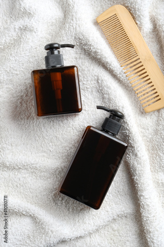 Foto Hair care products on white towel in bathroom