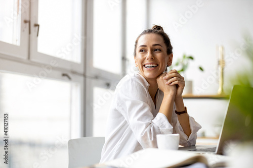 Obraz Creative young woman working on laptop in her studio  - fototapety do salonu