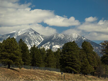 Snow Capped San Francisco Peaks, View Near Flagstaff Arizona. These Snow Covered Mountains Are An Eroded Stratovolcano..