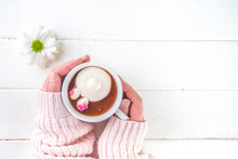 Easter Hot Chocolate With Marshmallow Bunny Rabbits. Girl Hands Hold Cup With Funny Hot Cocoa Drink, Wooden Background Copy Space Top View
