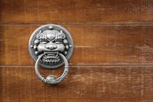 Bronze Vintage Chinese Lion Head Door Knocker On Wood Door.
