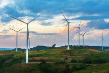 Evening View Of Wind Turbines Or Windmills Farm Field And Mountain Hill In Phetchabun, Thailand.