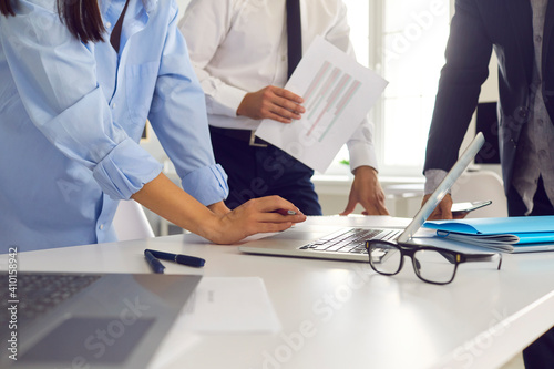 Obraz Workplace of young talented business people with laptops and documents on the desk. - fototapety do salonu