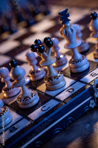 Chess board with chess pieces on blue background Fototapeta