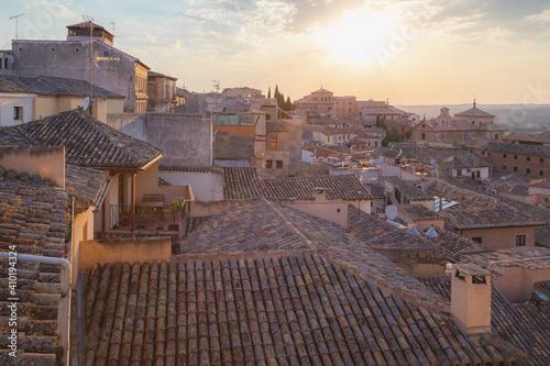 Fotografie, Obraz Golden light of a setting sun over terracotta rooftops in Toledo, Spain