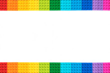 Frame Of Multicolor Lego Constructor Bricks On White Background. Popular Toys.