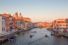 Evening Golden Light On The Bustling Iconic Tourist Attraction Grand Canal In Venice, Italy.