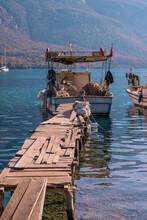 Traditional Turkish Fishing Boat Tethered To A Rickety Pier At Akbuk Limani, Gokova, Turley