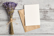 Greeting Card Mockup With Envelope And Dry Lavender Flowers On Wooden Background
