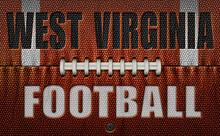 West Virginia Football Text On A Flattened Football