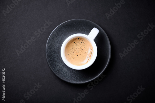 Fotografía Cup of coffee on black background. Top view. Copy space.