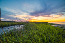 Sunset Over The Marsh With Colorful Sky