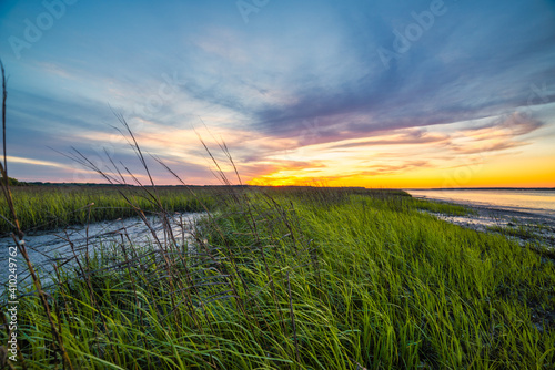 Fotografia Sunset over the marsh with colorful sky