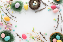 Top Down View Of Easter Decorations Arranged In A Border With Copy Space In The Middle.