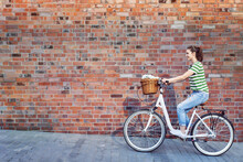 Woman Riding On The Background Of A Brick Wall, Poland, ≈õlƒÖskie, Katowice