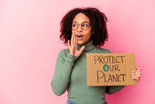 Young African American Mixed Race Woman Holding An Protect Our Planet Cardboard Is Saying A Secret Hot Braking News And Looking Aside