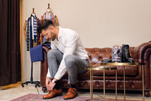 Man Fastening Monk Shoe In Tailors Boutique