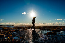 Silhouette Of Senior Woman Walking By St. Lawrence River, Quebec, Canada
