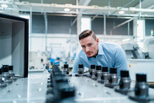 Male Professional Examining Machine In Industry