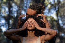 Female Dancer Covering Eyes During Performance With Male Partner