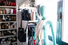 White Scarf On Blue Female Mannequin Against Window In Wardrobe At Home