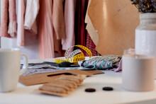 Tape Measure With Textile On Desk In Design Studio