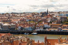 Aerial View Of Cityscape Against Cloudy Sky On Sunny Day, Whitby, Yorkshire, UK