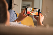 Mature Woman Watching Food Recipe On Smart Phone At Home