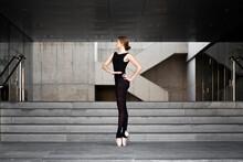 Ballerina In Black Leotard In Modern Concrete Building