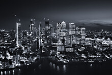London, United Kingdom - 29 December 2020: Aerial View Of London Financial District Of Canary Wharf At Night Along The River Thames.