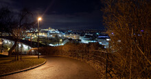 .street Lights And Pedestrian Walkway In The Park And In The Background A View Of The City Of Prague And Prague Castle At Night In The Center Of Prague In The Czech Republic