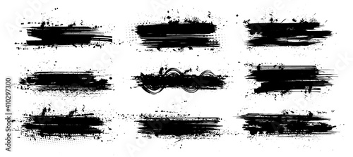 Fototapeta Ink paintbrush template with splashes. Vector collection black grunge paintbrush, ink brush stroke. Dirty artistic design elements. Inked splatter, dirt stain, splatter, brush with drops blots. Vector obraz