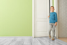 Cute Little Boy Opening Door In Room