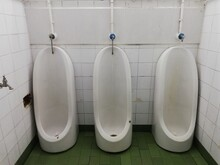 The Interior Of Old Dirty Public Toilet Urinals In Men Toilet With Very Bad Conditions