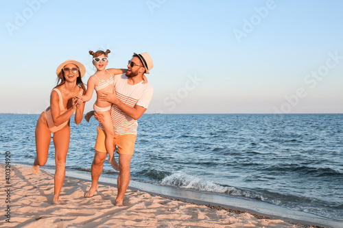Happy family on sea beach