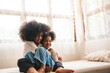 African American children  girl having fun to play with her sister, childhood family at home concept