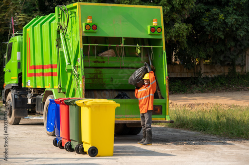 Fototapety, obrazy: Worker collecting garbage of urban municipal are collecting for trash removal.