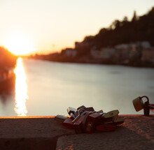 View Of The Sunset On A Bridge Where There Are Different Padlocks Symbolizing The Union And Love Of The People Who Put Them There.
