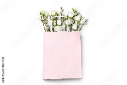 Obraz Pink paper bag with roses and willow catkins isolated on white background - fototapety do salonu