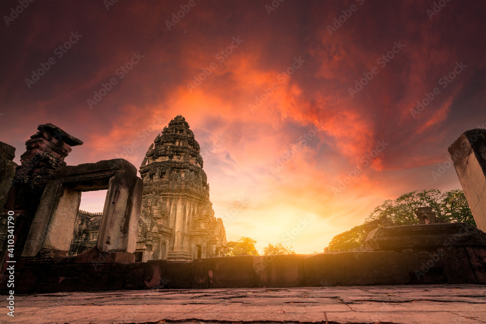 Fototapeta Selective focus on Phimai Historical Park with sunset sky. Landmark of Nakhon Ratchasima, Thailand. Travel destinations. Historic site is ancient. Ancient building. Khmer temple classical architecture