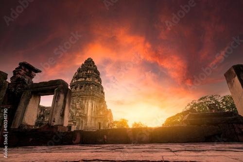 Fototapeta Selective focus on Phimai Historical Park with sunset sky. Landmark of Nakhon Ratchasima, Thailand. Travel destinations. Historic site is ancient. Ancient building. Khmer temple classical architecture obraz