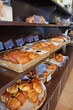 Assorted bread and toast displayed in bakery pastry shop
