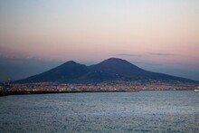 Naples, Italy, June 26, 2020 Evocative Image Of Vesuvius Seen From The City At Sunset