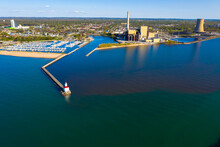 Aerial View Of Michigan City East Pierhead Lighthouse And The Electric Power Plants In Chicago, Illinois, United States Of America.