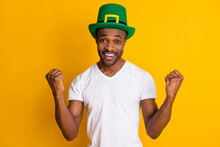 Astonished Positive Cheerful Afro American Guy Win Saint Patrick Competition Impressed Delighted Raise Fists Scream Wear White Green Hat Outfit Isolated Bright Shine Color Background