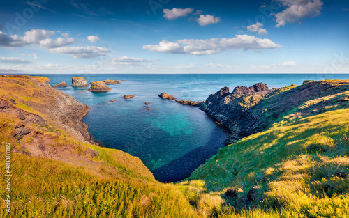 Beautiful summer scenery. Sunny morning view of outskirts of Arnarstapi or Stapi village. Wonderful outdoor scene of Iceland, Europe. Atlantic ocean seascape.