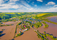 Aerial Landscape Photography. Flooded Villages In Western Ukraine. Flood On The Dniester River. View From Flying Drone Of Nyzhniv Village After Few Days Of Huge Rain. Disaster Concept Background.