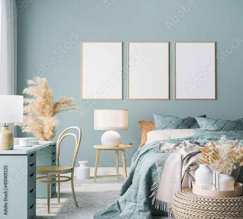 Obraz Blue Scandinavian bedroom with three vertical frames in bright design, poster mock up on boho wall background - fototapety do salonu